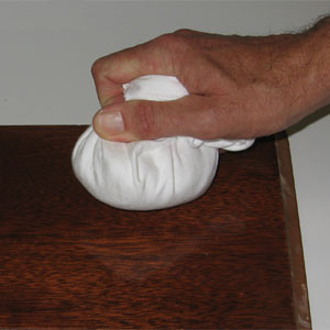 Applying French polish with a pad.