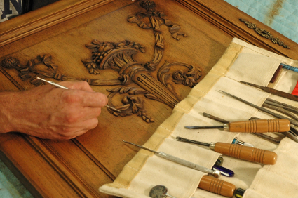 Skilled Craftsman Restoring A Piece Of Furniture.