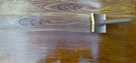 Creating a faux good grain using a graining rocking tool and wood stain.