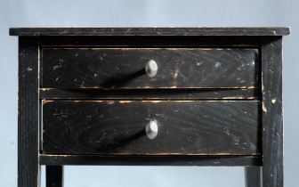 Chamfered small black end table.