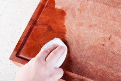Applying mineral oil to a cutting board.